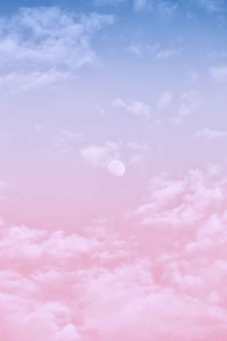 white clouds in pink and blue clouds